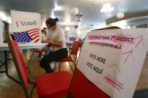Voters social distance on primary election day